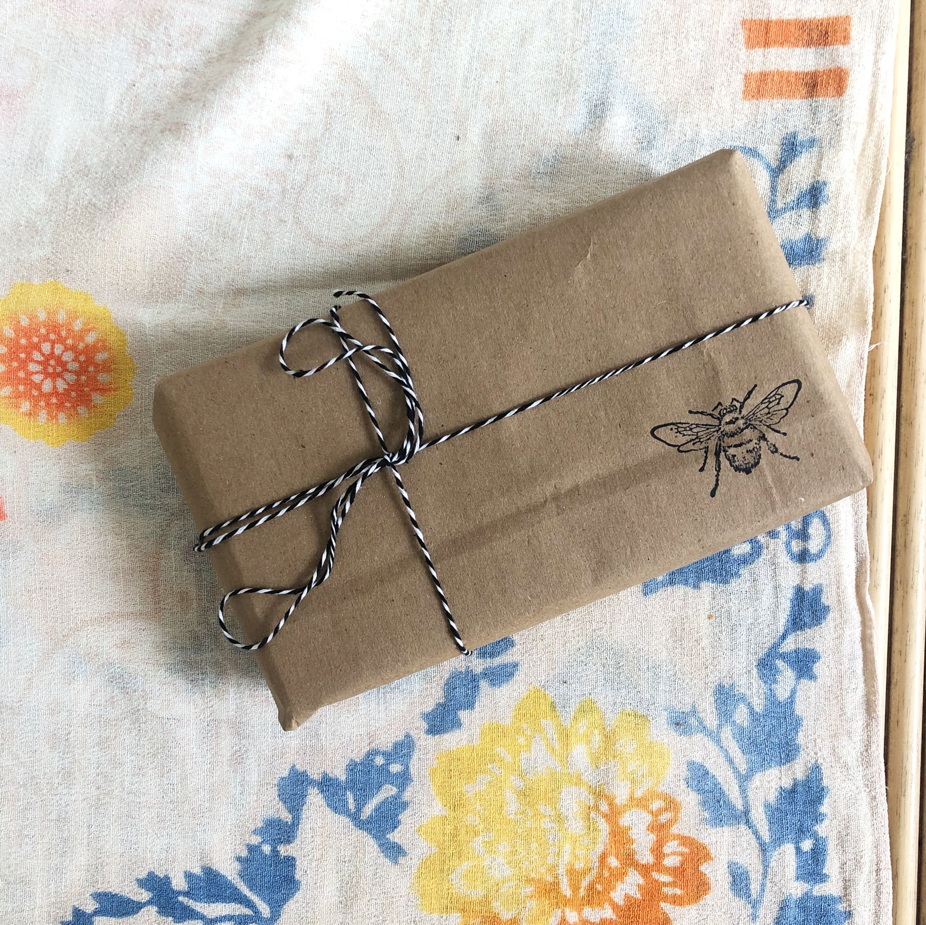 Recycle your paper bags and add a custom stamp to make a statement in your gift wrapping