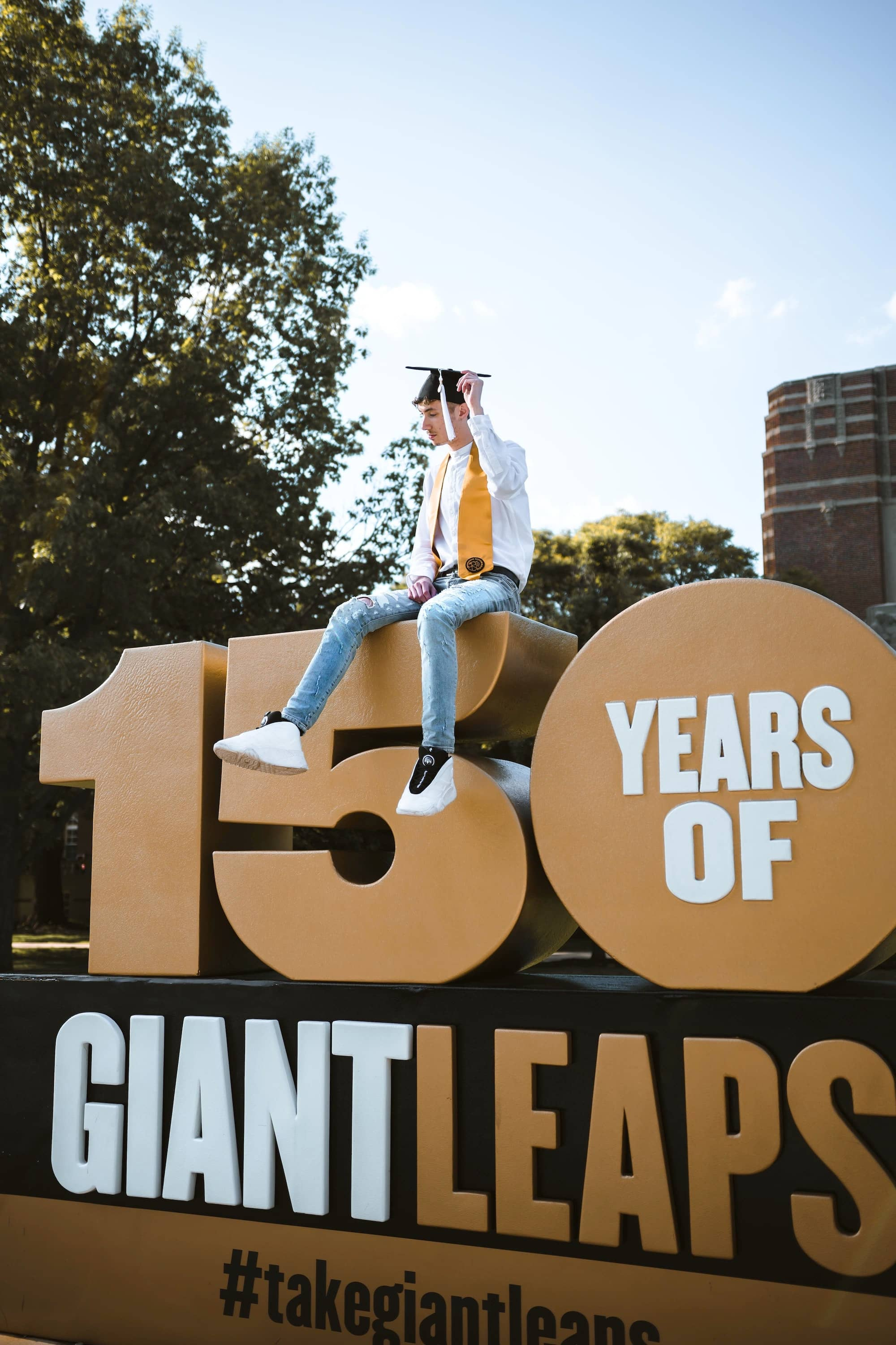 Use the campus or local backdrops for a graduation card announcement