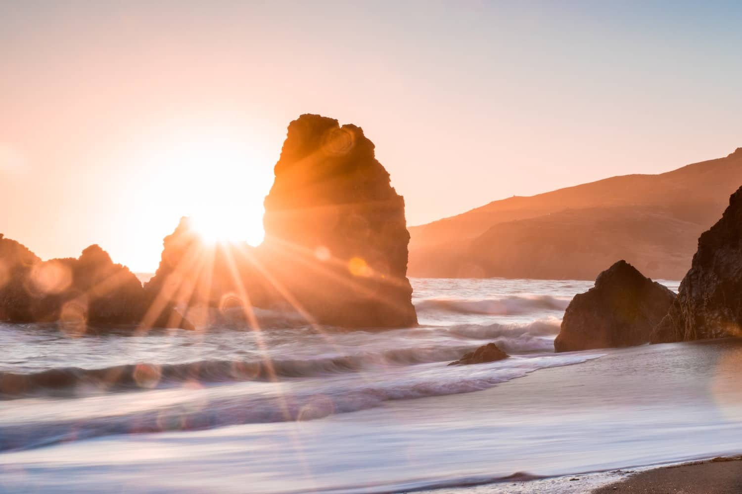 Sun stars make for magical subjects in your beach photography, try to capture them with these tips.