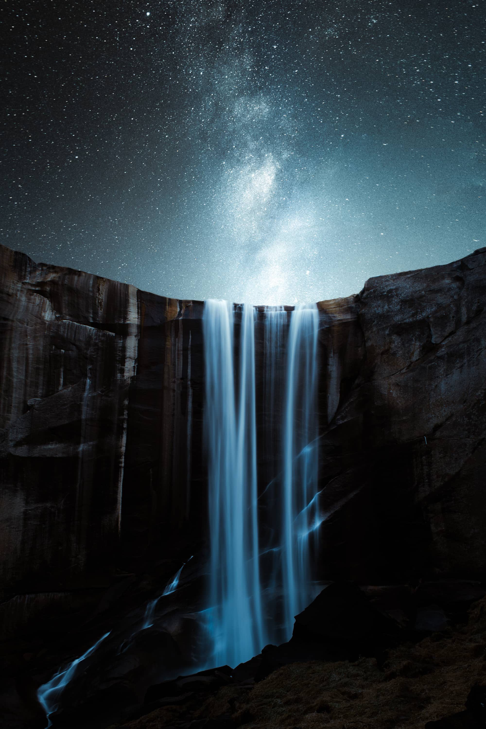 Waterfall With a Starry Night Sky by Jordan Mcgarth