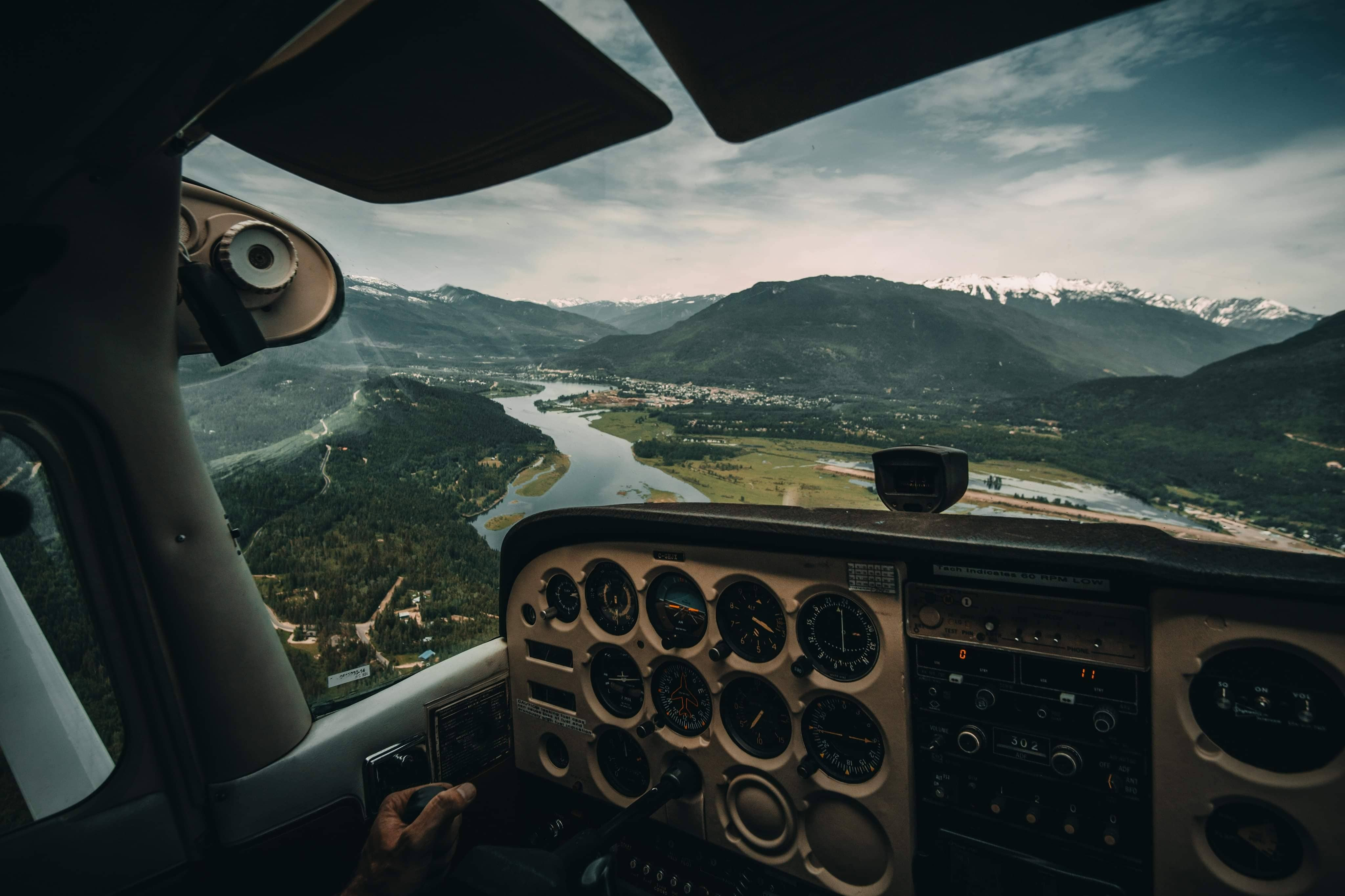 View from the Inside of a Plane Overlooking Mountains by Jordan McGrath