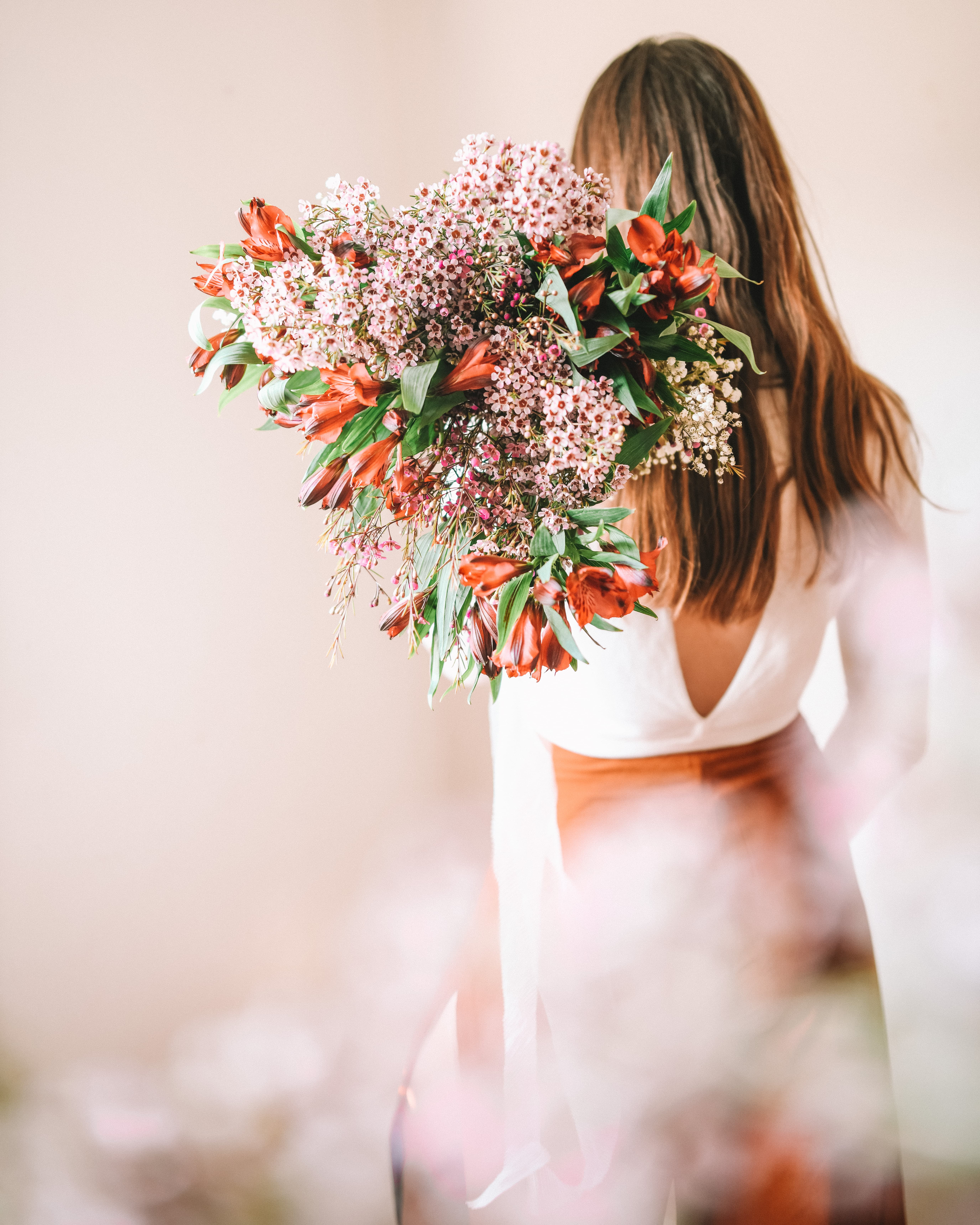 Girl with her back to the camera holding bouquet