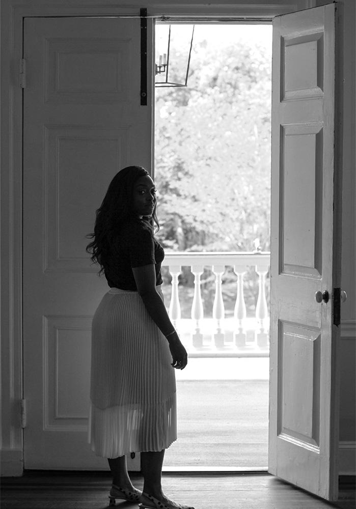 Hamida opening a door