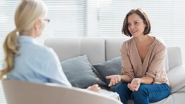 woman speaking to a therapist