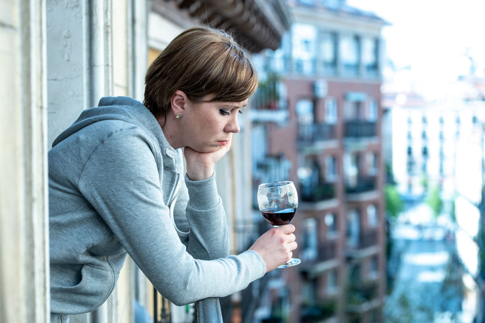 depressed woman drinking wine