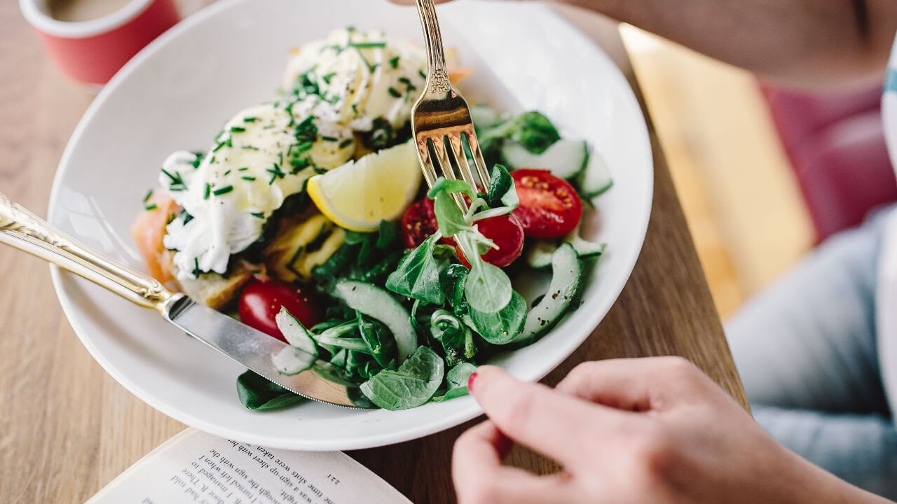 salad breakfast woman reading table morning tomatoes eggs