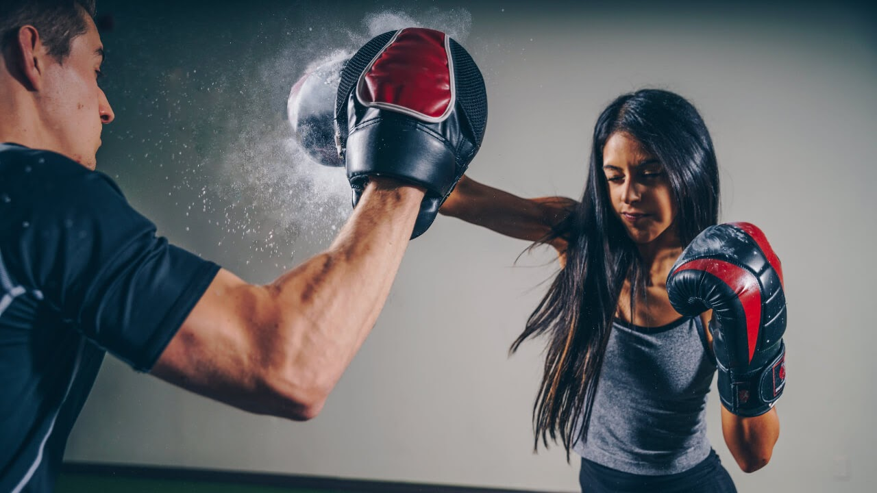man and woman boxing exercise therapeutic punch gloves