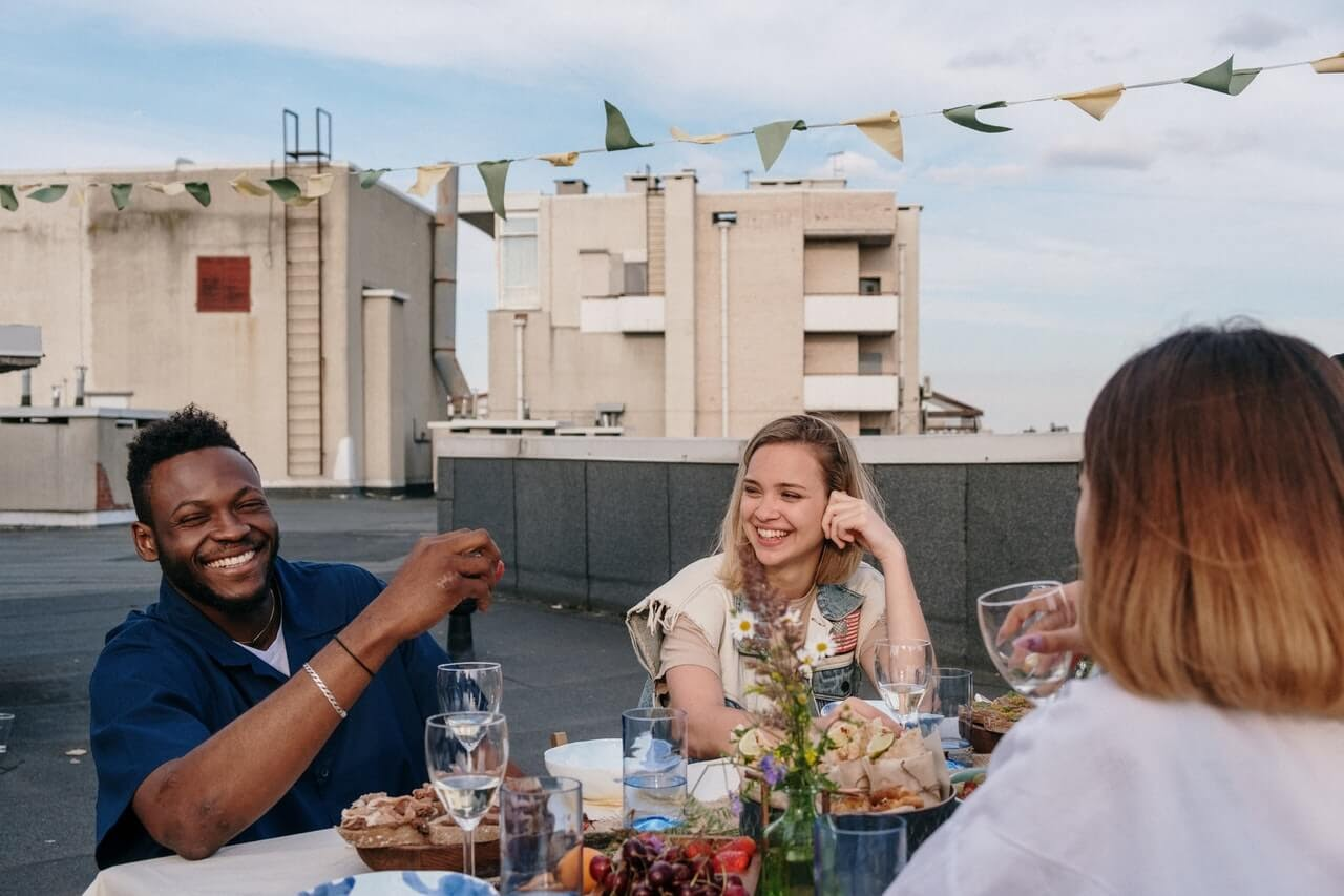 friends rooftop lunch drinks dinner laughter fun social
