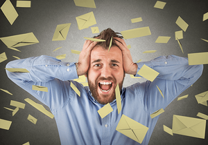 Stressed out man with email overload