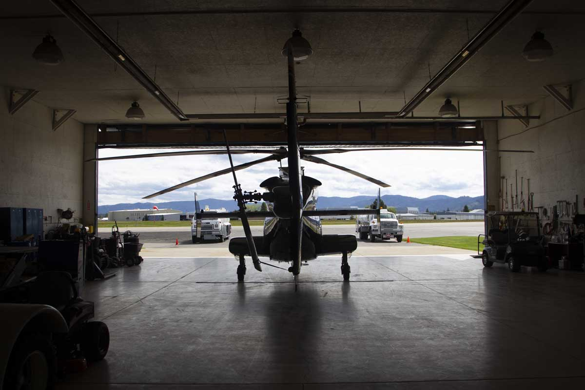 Helicopter inside of a hangar