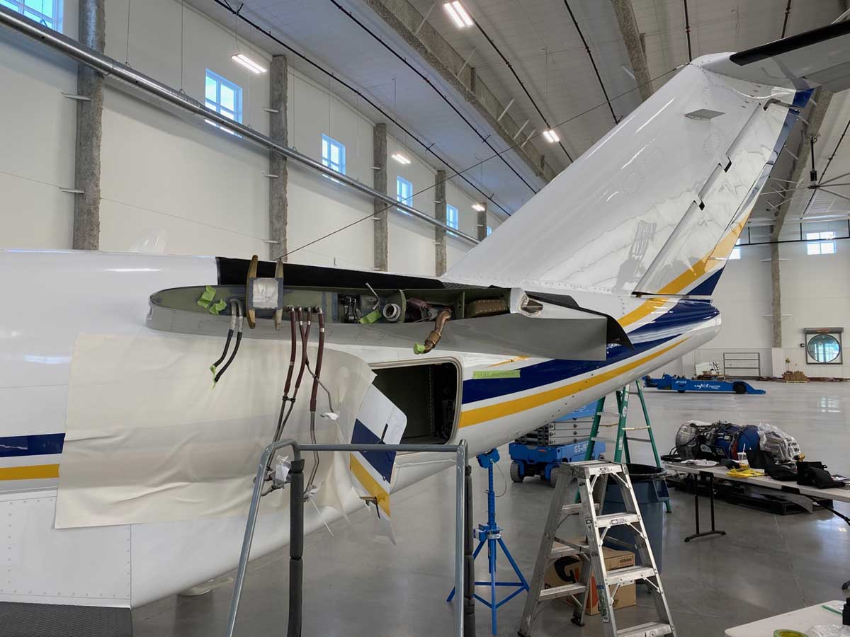 Maintenance on private jet inside of a hangar