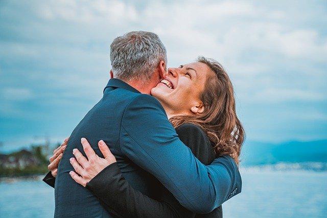 Man and women hugging