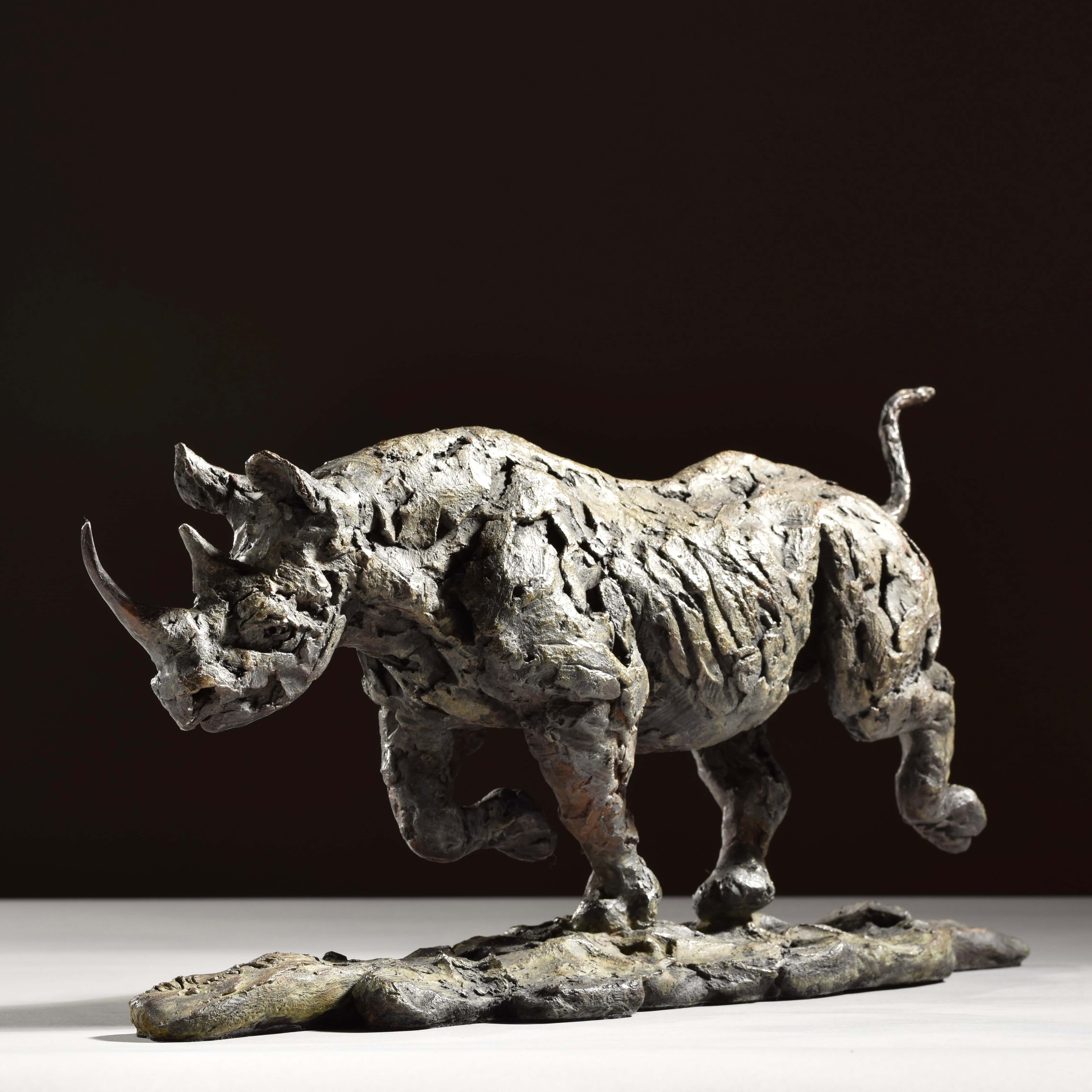 Black Rhino Running by Hamish Mackie at Muse. The Sculpture Company