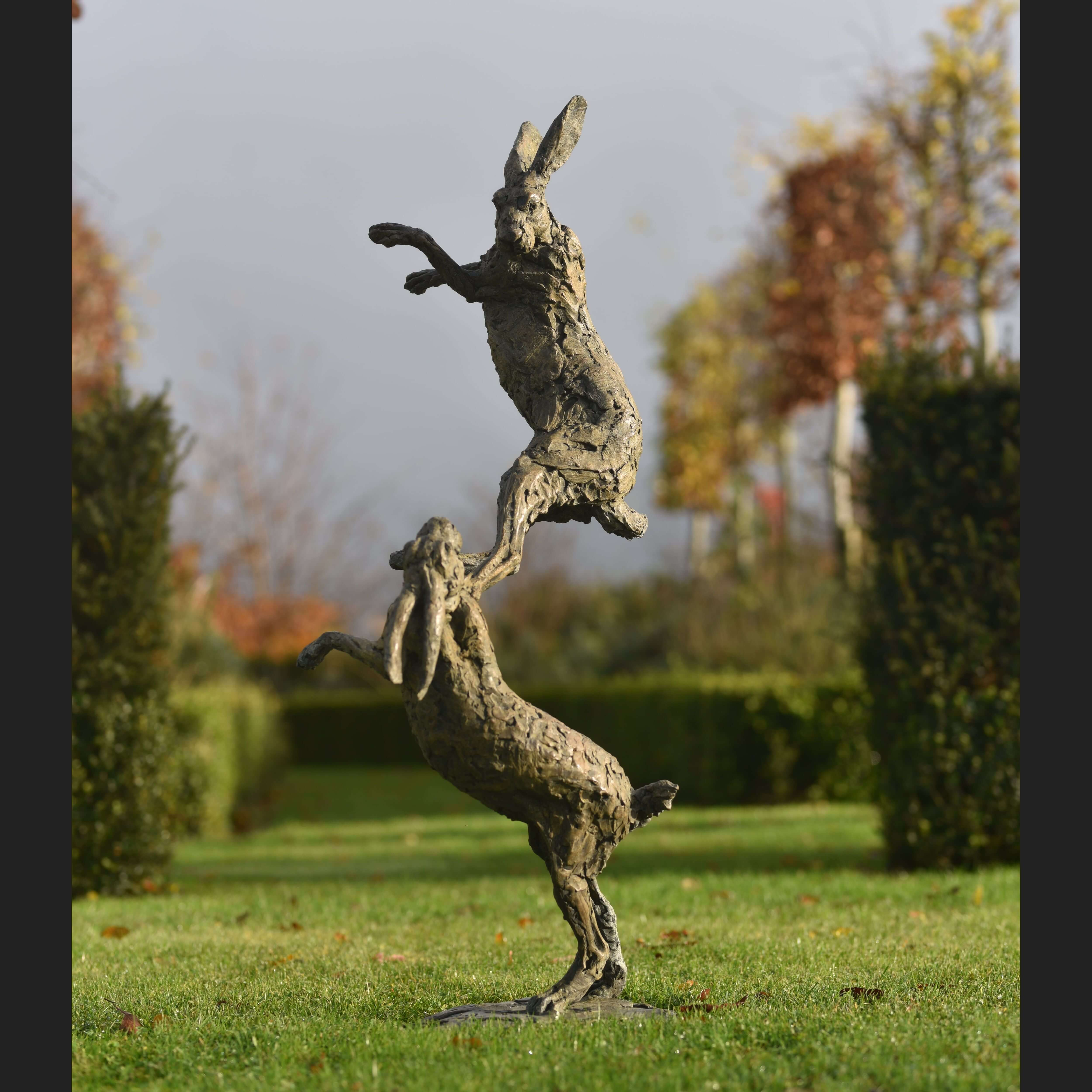 Hares Boxing by Hamish Mackie at Muse. The Sculpture Company