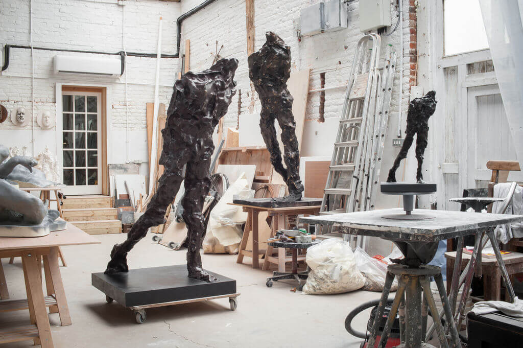 Striding Man by Maurice Blick with Muse the Sculpture Comoany