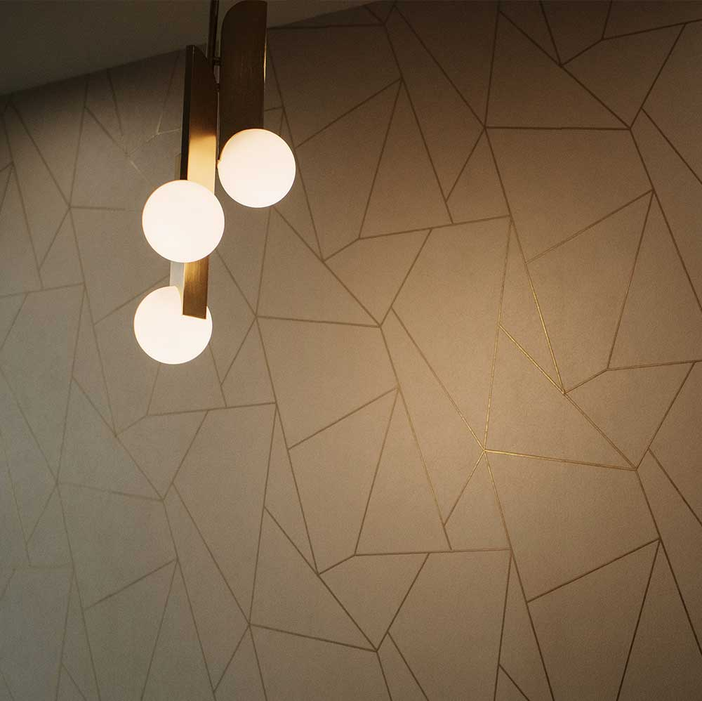 Photo of a hanging light fixture and a wall texture