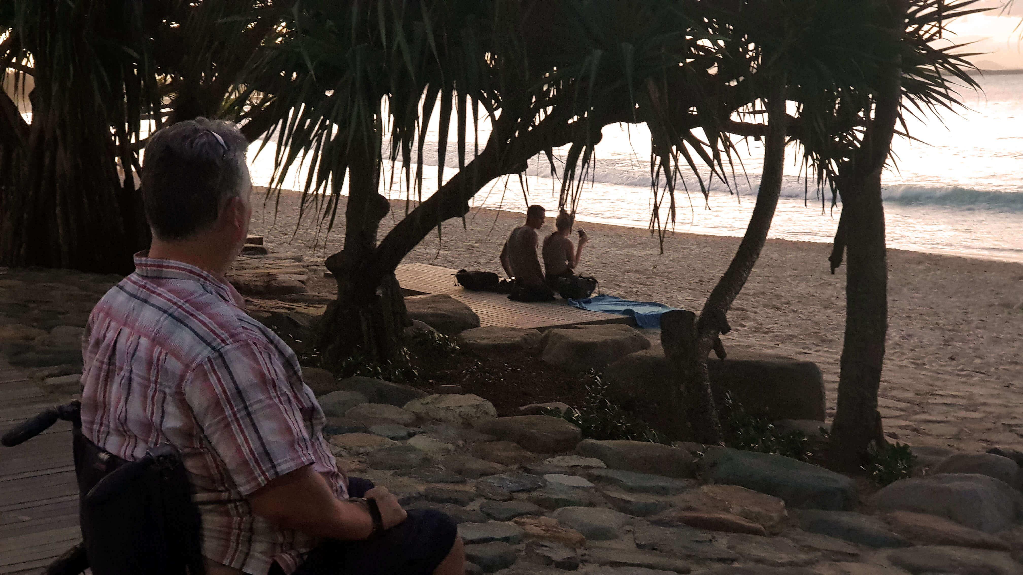 Man in Wheelchair looking over beach