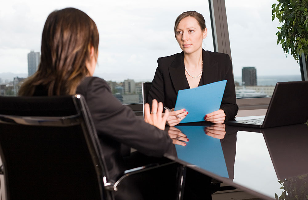 Woman respectfully conducting the termination interview of an employee