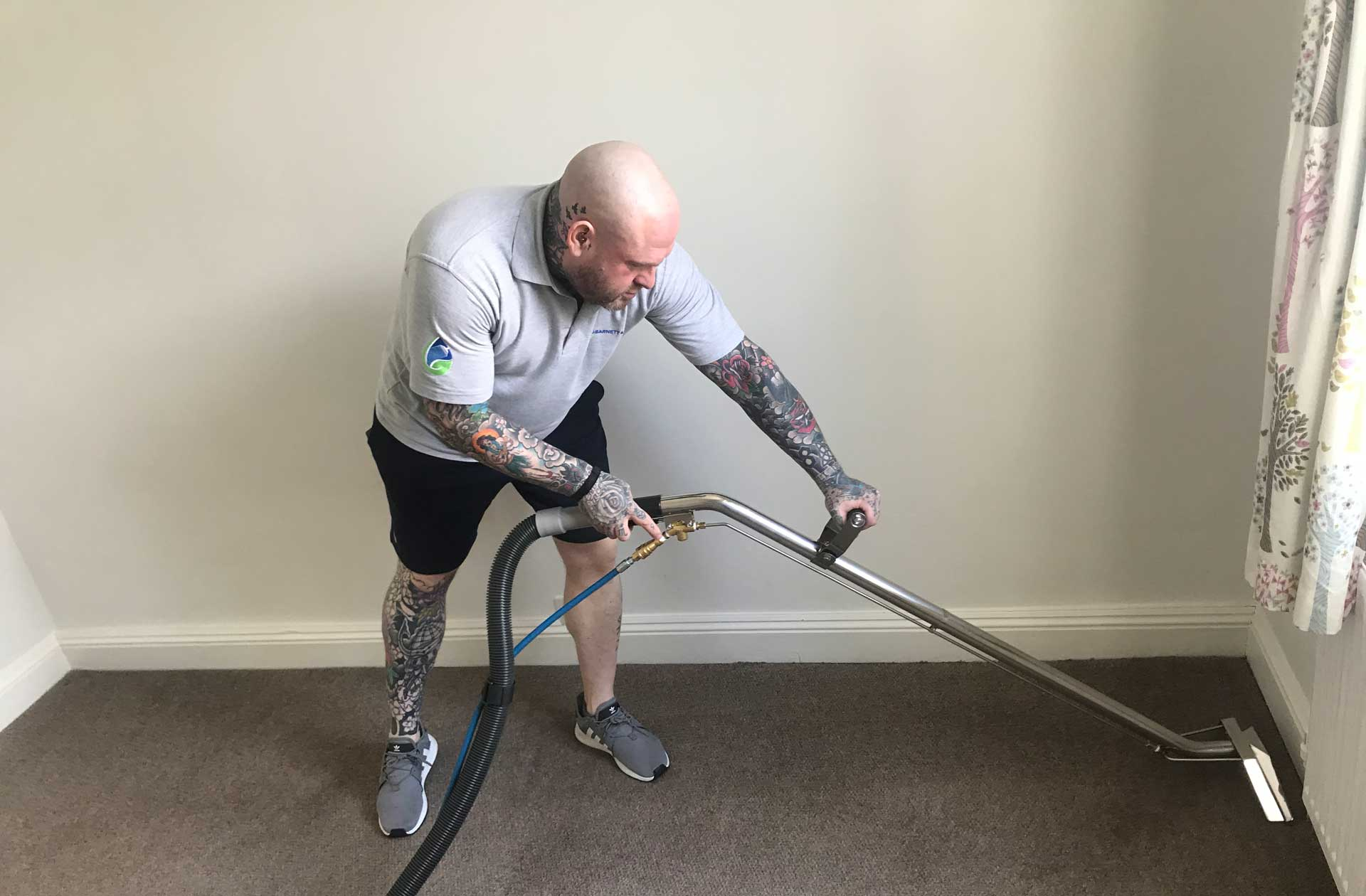 photo of Jason Barnett cleaning a carpet with machine