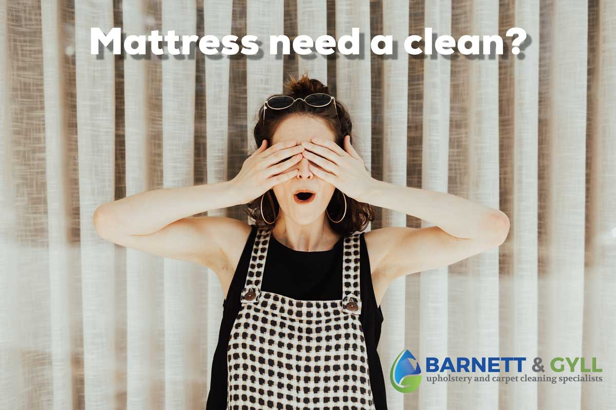 photo of a woman with her eyes closed as mattress is dirty