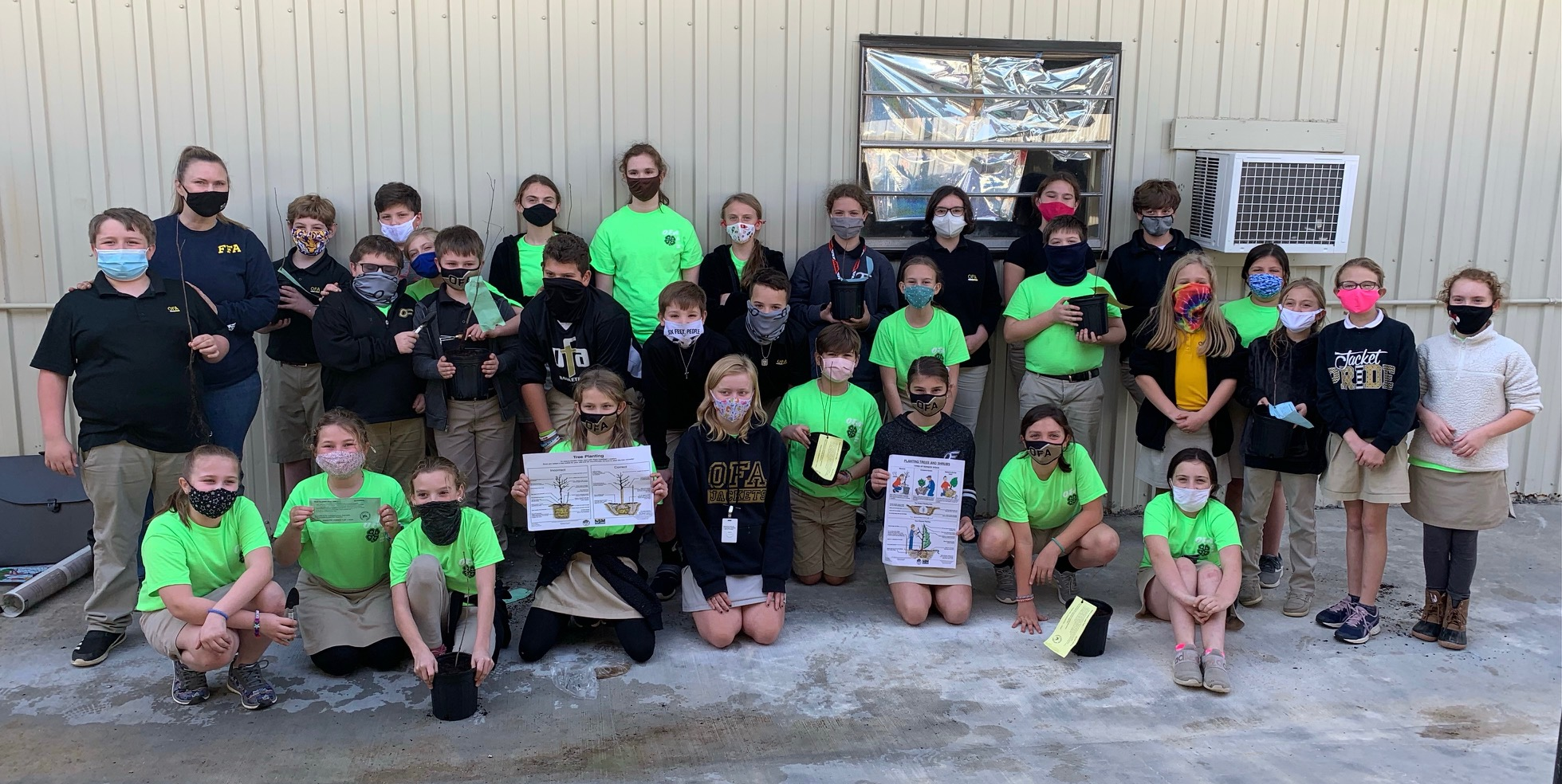 4H Club learning to plant seedlings