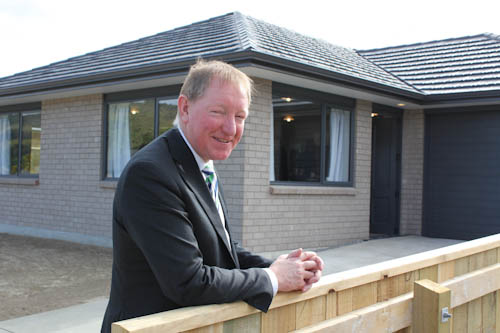 Dr Nick Smith outside a new Accessible Properties home