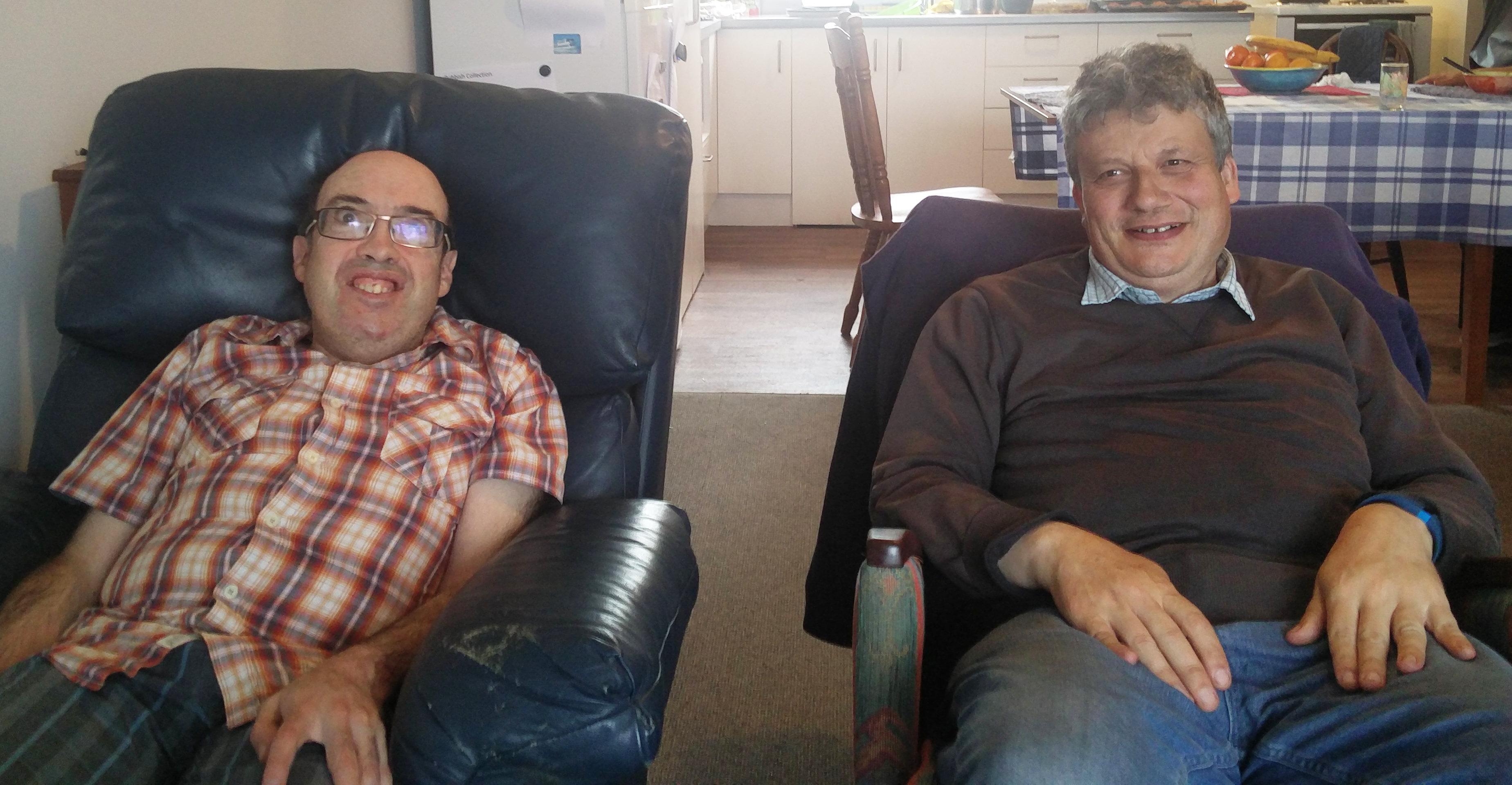 Adam Gibbs and Daniel O'Sullivan in their lounge