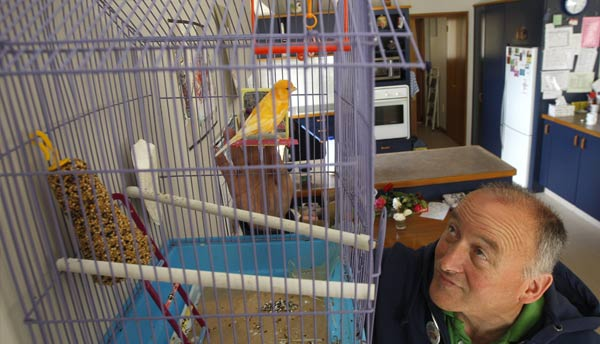 Accessible Properties tenant caring for his bird in his home