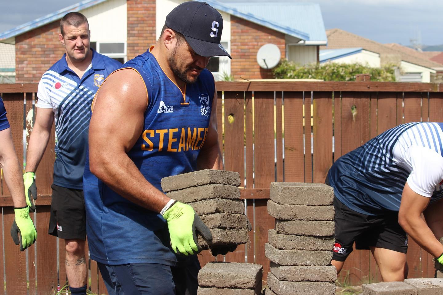 Members of the Bay of Plenty Steamers helping to move paving stones