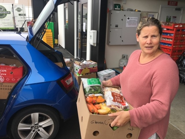 Georgina Willers from Accessible Properties delivers a food parcel