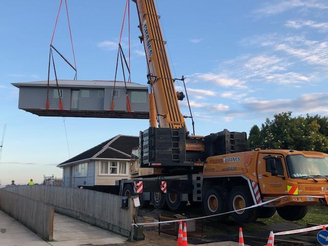 Crane lifts home