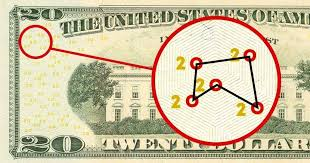 Close up of a twenty-dollar US bill, with a mapped constellation of circles shown.