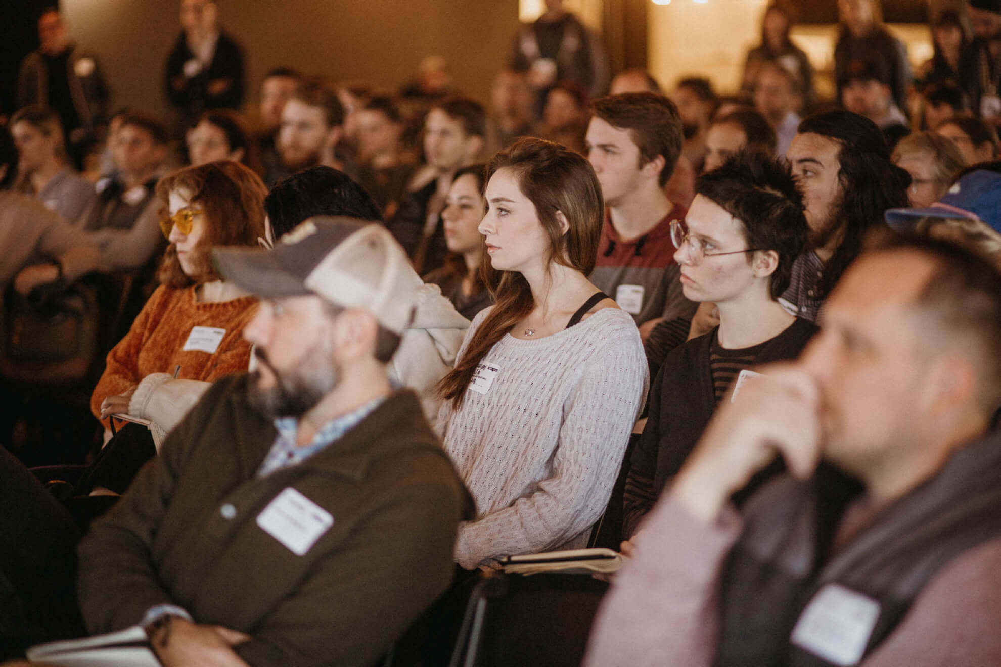 An audience listening to a speaker at Creative Mornings in Chattanooga