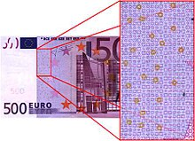 A five-hundred dollar Euro note, with a close-up showing a specific constellation of circles.