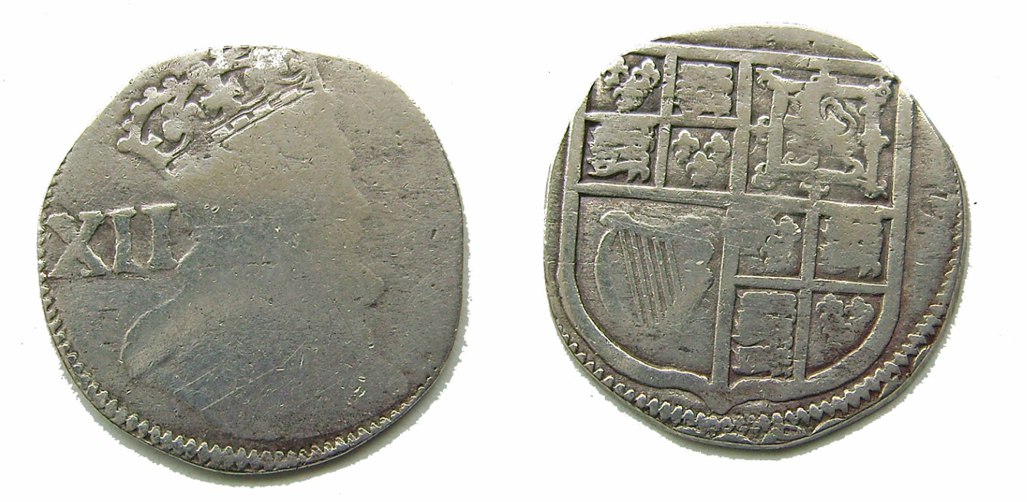 Coins with ridges and worn edges, potent evidence of the intentional shaving off of a small portion of metal coin for profit.