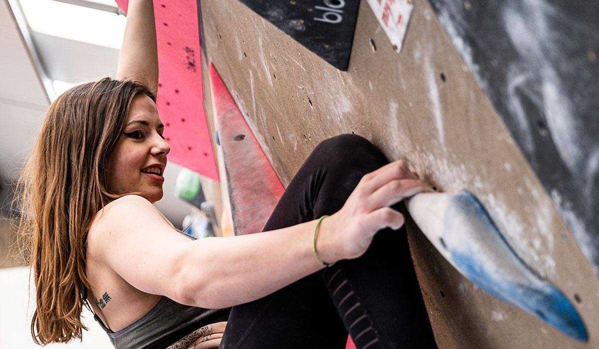 Girl Bouldering Wall