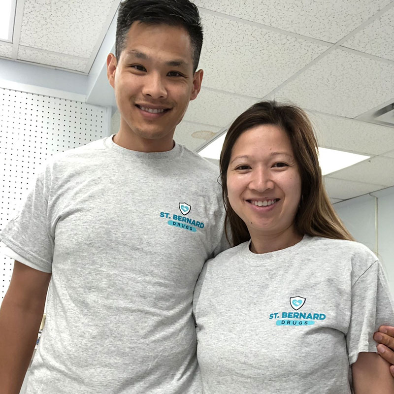 St. Bernard Drugs staff wearing branded t-shirts.