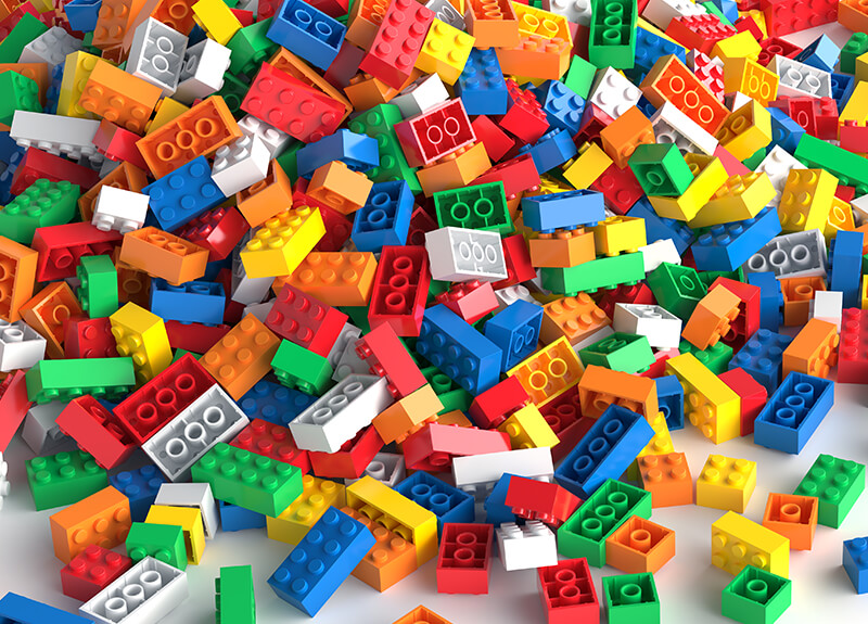 A pile of mulitcolored toy bricks.