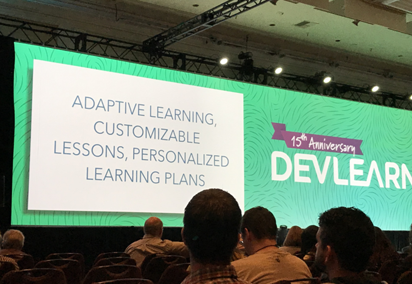 A large DevLearn screen displaying in front of an audience - OttoLearn Agile Microlearning