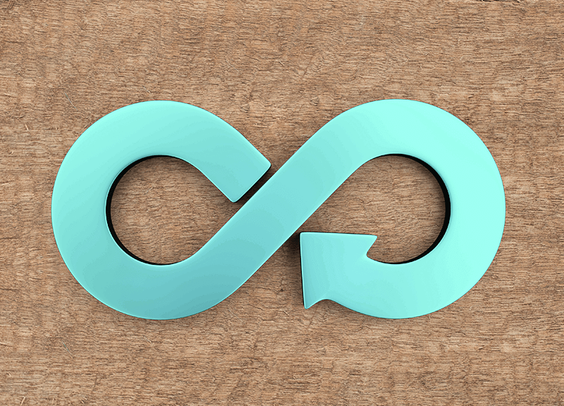 A blue infinity symbol on a light brown wood background - OttoLearn Adaptive Learning