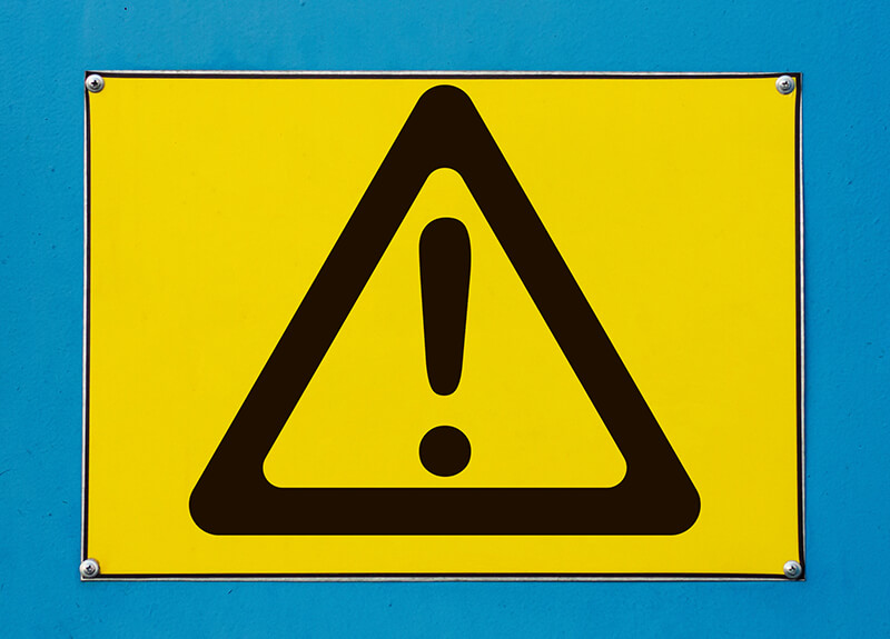 Yellow warning sign on a blue background - OttoLearn Adaptive Learning