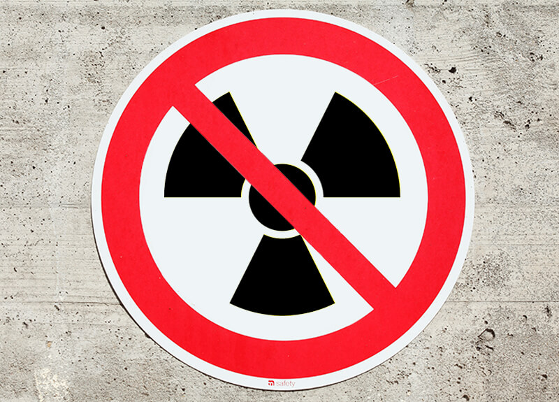 "A radioactive symbol within a ""Do Not"" red circle."