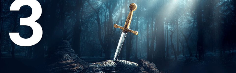 Post #3; Close-up of a sword with a golden hilt stuck in a stone, surrounded by a forest.