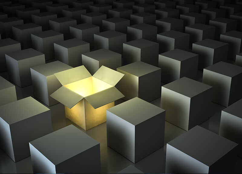 Rows and rows of generic dark grey cubes, with one open box that is glowing a bright yellow-white, like a lit-up bulb.