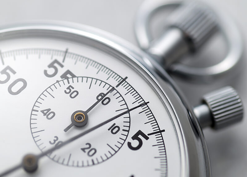 Extreme close-up of a silver stopwatch.