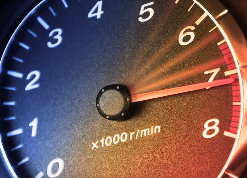 Extreme close-up of a speedometer showing the needle pointing to the maximum speed.
