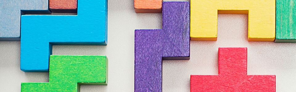 A series of colourful wooden blocks in shapes that fit together like a puzzle.