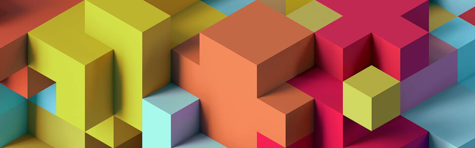 Blocks of various shapes and colors interlocking together.