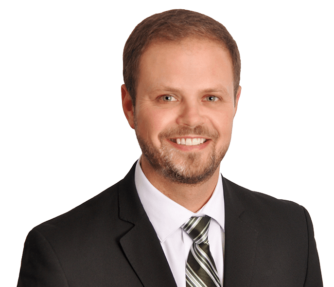 Portrait of a smiling man with a close cropped beard and short brown hair - Josh Flower, Microlearning Expert
