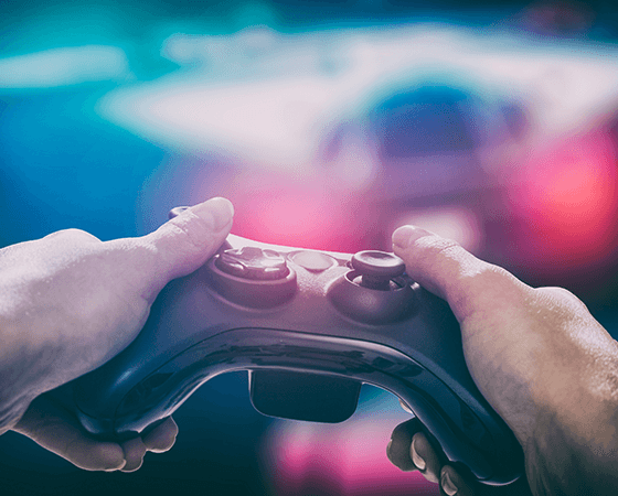 Image of hands holding onto a game controller - OttoLearn Agile Microlearning